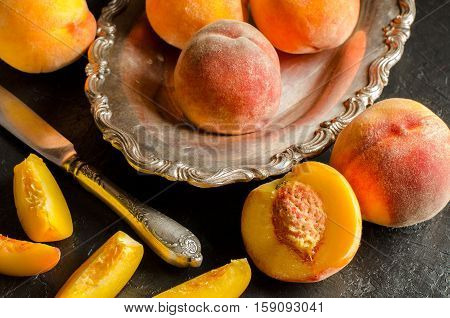 Peaches On A Dark Background. Whole And Sliced Juicy Peaches.