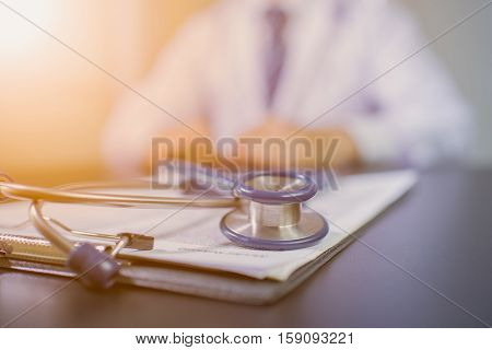 Medicine doctor's working table. Focus on stethoscope black and white. Technology doctor. Doctor hand. Doctor man. Tool doctor. Doctor room. Doctor clinic.