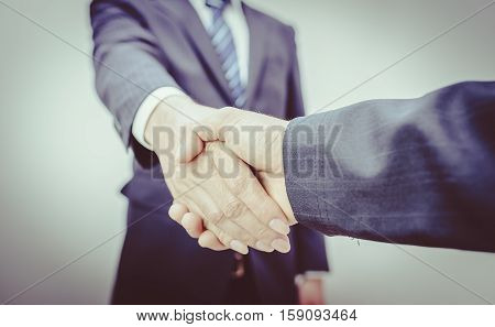 Business Man. Business handshake and business people vintage tone. refinery on sunrise. Business handshake and business people. Shake hands after their meeting. man handshake. Business concept. Business working.