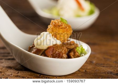 Filet Mignon With Spices, Lemon Zest, Creamy Curd And Fried Banana In A Spoon. Taste Gastronomy Fing