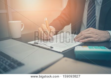 Man Analysis Business Accounting. Close-up photo vintage tone. Business room. Business man. Business writting. Business looking. Business reading.