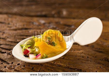 Shrimp Tortelline, Morning Gravy, Radish And Black Salt In A Spoon. Taste Gastronomy Fingerfood
