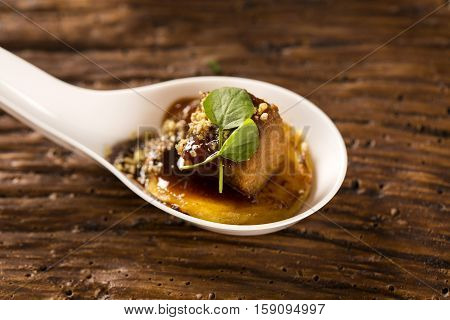 Pork Tongue, Ground Banana, Marsala Reduction, Water Meal And Mini Watercress In A Spoon. Taste Gast