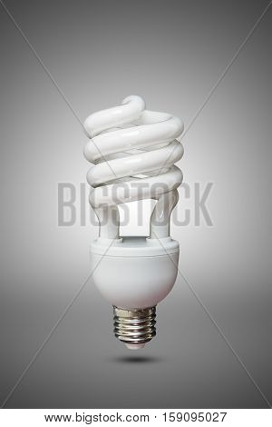 Compact Fluorescent bulb in gray background .