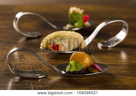 Cassava Empanada And Caramelized With Purple Onion Jam In A Spoon. Taste Gastronomy Finger Food