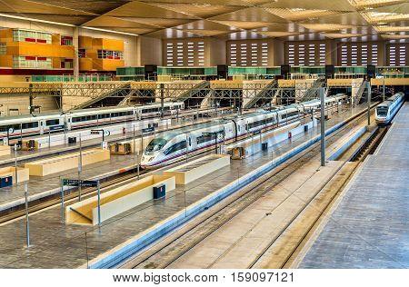 Zaragoza, Spain - October 9, 2016: High-speed and regional trains at Zaragoza-Delicias station
