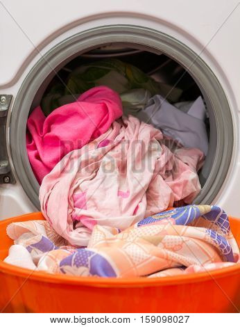 Laundry. Washing clothes in a washing machine at home