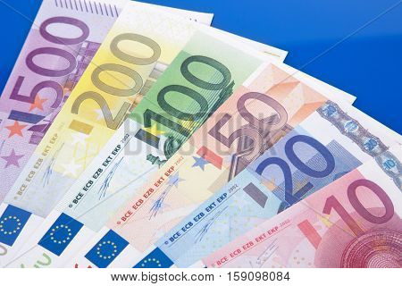Various euro notes on blue background