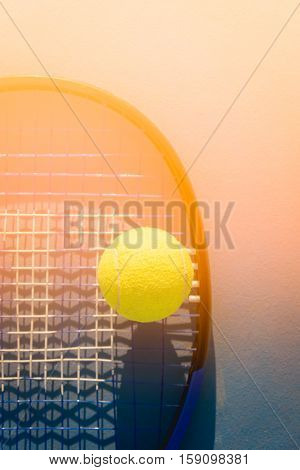 Tennis Ball and Racket in tennis cort, Tennis court, Tennis ball, Tennis racket, shadow tennis, Tennis sport, Tennis concept, Tennis ball green color, Tennis racket blue color, sunset