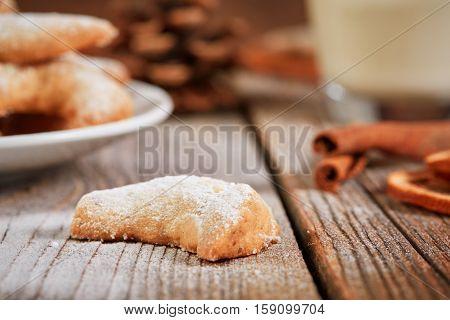 Single Vanilla Cookie On A Wooden Table