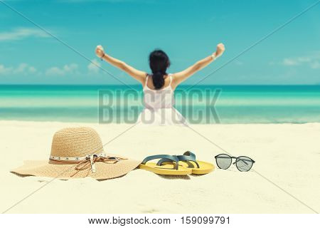 Shoes glasses and hat on the beach. The white sand beaches from Thailand. Yellow shoes Brown hat Riksdag black goggles on the beach. vintage tone