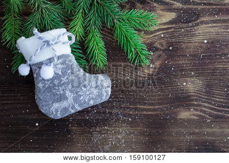 Composition Of Christmas Tree Branches And Grey Knitted Stocking, Copyspace