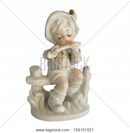 Serial porcelain figurine of a boy playing a flute from the decor store isolated on white