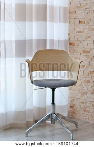 Chair and colorful striped curtains