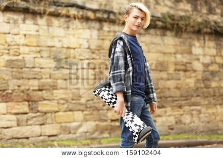 Teenager boy with hoverboard outdoors