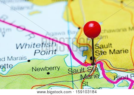 Sault Ste Marie pinned on a map of Michigan, USA