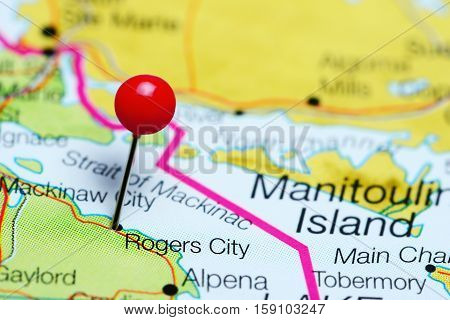 Rogers City pinned on a map of Michigan, USA