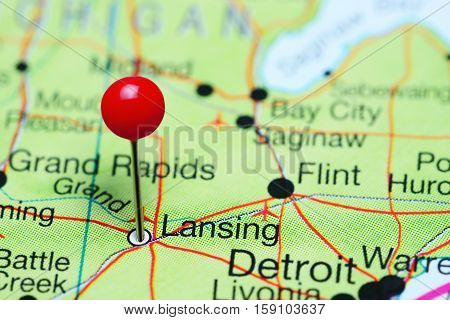 Lansing pinned on a map of Michigan, USA