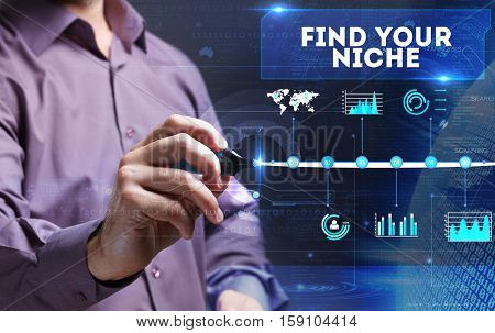 Technology, Internet, Business And Marketing. Young Business Man Writing Word: Find Your Niche