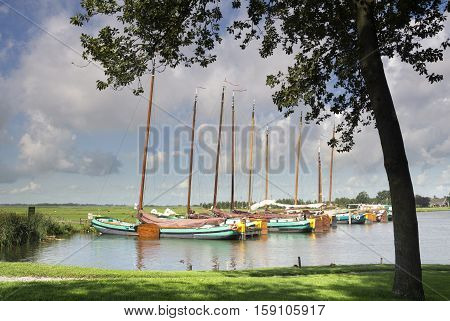 Sailing ships in the Sleattemer Gat near Sloten in the Dutch province Friesland