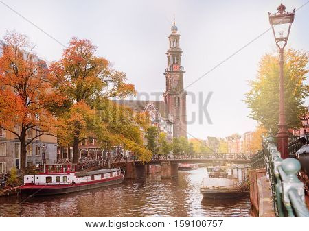 View on one of the famous Amsterdam canals and Westerkerk in autumn