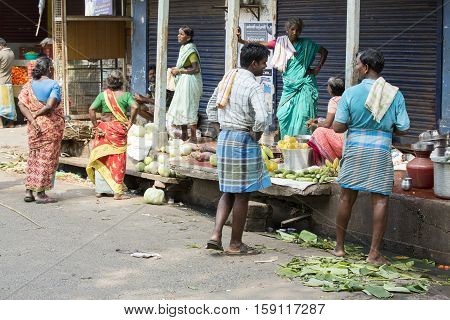 Illustrative image. Pondicherry Tamil Nadu India. February 24 2014. Market place with a lot of shops and people buying selling varieted products