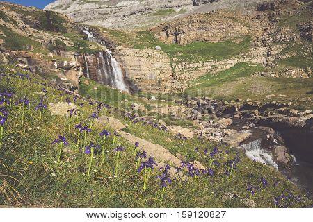Waterfall de cotatuero under Monte Perdido at Ordesa Valley Aragon Huesca Pyrenees of Spain