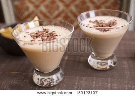 Two glasses filled with a milk amaretto hazelnut liqueur drink for a holiday get together