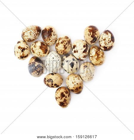 Heart shape made of quail eggs isolated over white background