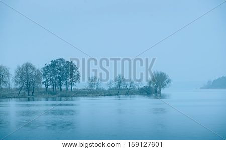 Cold Blue Toned Lake In Winter