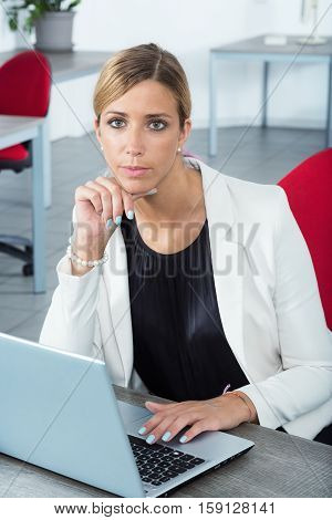 Elegant Woman Using A Laptop In Her Office