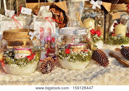 CLUJ-NAPOCA ROMANIA - DECEMBER 5 2015: Christmas decorations festive table centerpieces gifts and souvenires for sale at the Christmas market stalls.