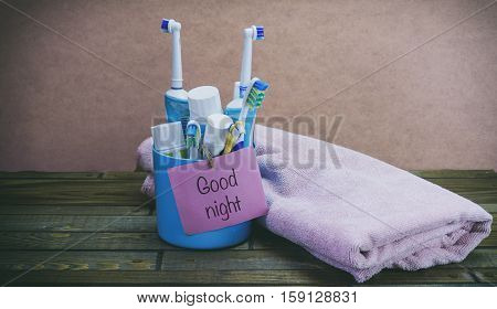 Toothbrushes In A Glass Bath A Towel, A Word On The Paper Stick