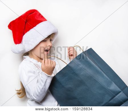 maiden in a red cap looking for the gifts in the package