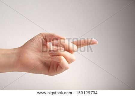 Female hand with contact lens on finger against light background. Medicine and vision concept