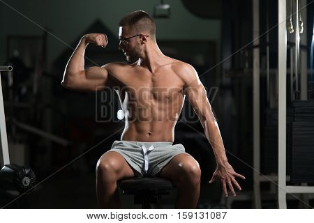 Serious Bodybuilder Wearing Goggles Sitting In The Gym