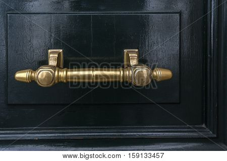 Vintage gate latch on the wooden door