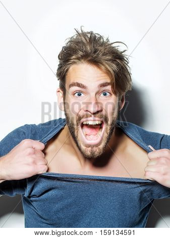 Excited Man Rips Tshirt Open