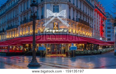 Paris France-November 26 2016 : The Christmas decoration on Fouquet's restaurant located at Champs Elysees avenue in Paris.Fouquet's is a historic restaurant was founded in 1889.