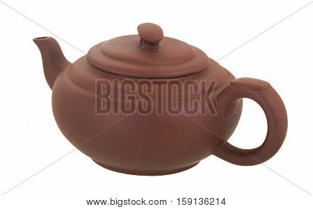 Ceramic teapot on a white background. The teapot from brown clay is isolated on a white background