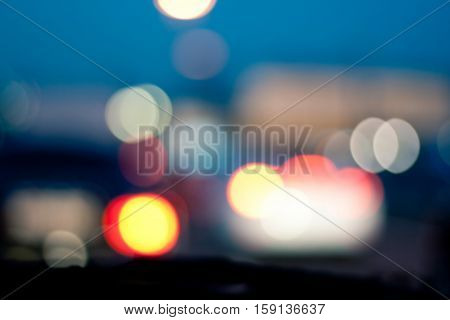 Intentionally Blurred Background. Heavy Traffic On Evening Road. Bokeh. Car Headlights On Congested