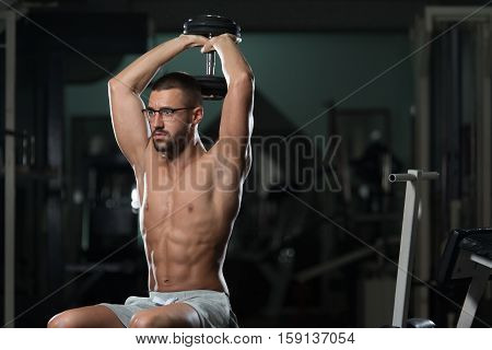 Geek Man With Dumbbell Exercising Triceps