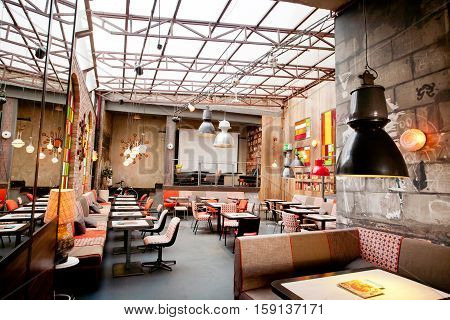 KRAKOW, POLAND - JUL 31, 2014: Interior design of a popular restaurant in the center of the old town on July 31, 2014. Krakow with popul. of 800000 people has 2.35 mill. foreign tourists annually