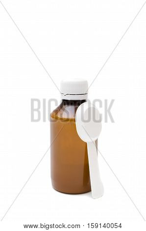 mixture and measuring spoon, a bottle of the medical preparation