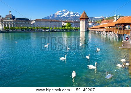 Historic City Center Of Lucerne With Famous Chapel Bridge And Water Tower