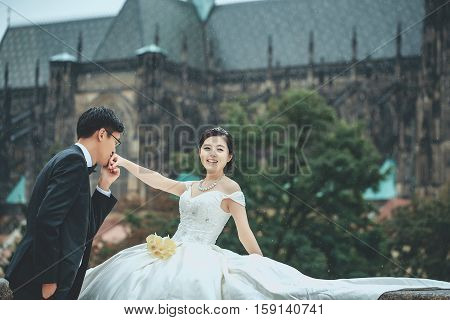 Chinese Cute Young Newlyweds Outdoor