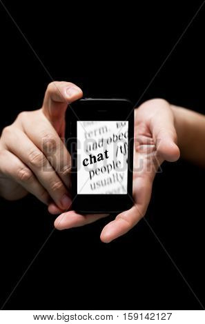 Hands Holding Smartphone showing Word Chat printed concept of communicating online with mobile (on black background with very shallow depth of field)