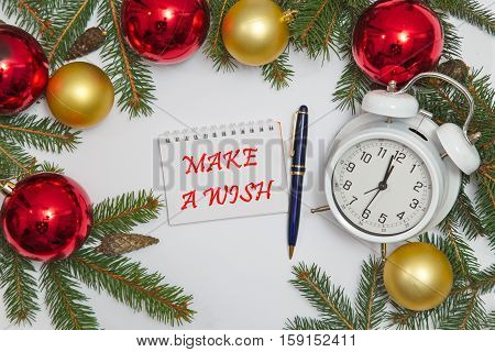 Notebook page with text MAKE A WISH with decoration and old clock, white background