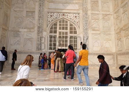 AGRA, INDIA - FEBRUARY 14 : Gate to the Taj Mahal (Crown of Palaces), an ivory-white marble mausoleum on the south bank of the Yamuna river in Agra, Uttar Pradesh, India on February 14, 2016.