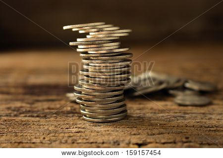 strack of coins make to differrent position concept idea for business or financial instability